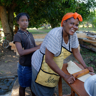 Lucianna and her daughter cooking up food
