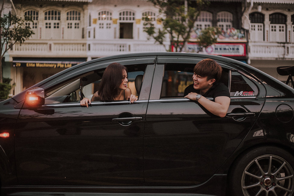 Couple in sports car street