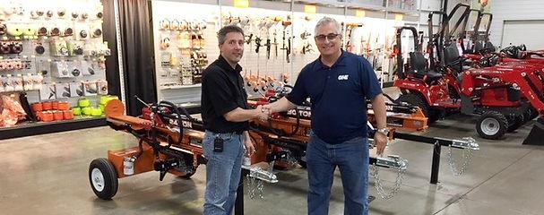 Great Northern Equipment sales representative and equipment dealer shaking hands