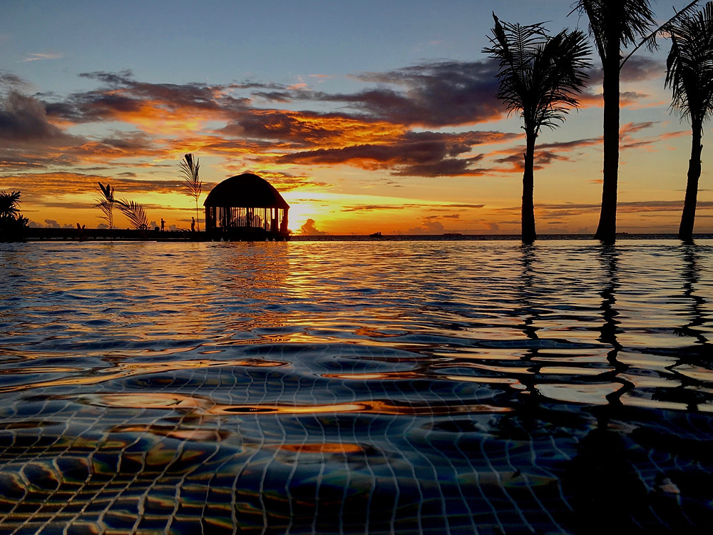 Ozen by Atmosphere - Main Pool at Sunset