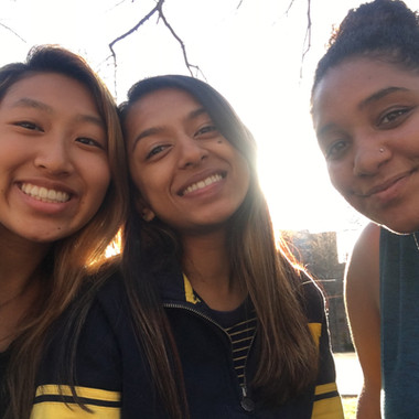 Kelly Chang, Anjali Nemorin, and Desirae Nelson hangout on the Diag on a beautiful spring day