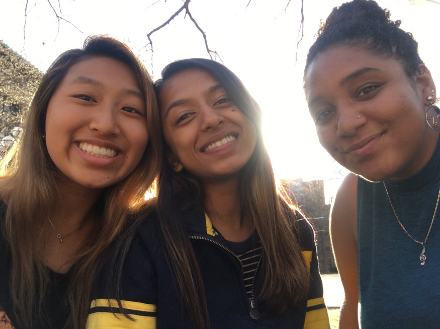 Kelly Chang, Anjali Nemorin, and Desirae Nelson hangout on the Diag on a warm spring day (Winter 2019)
