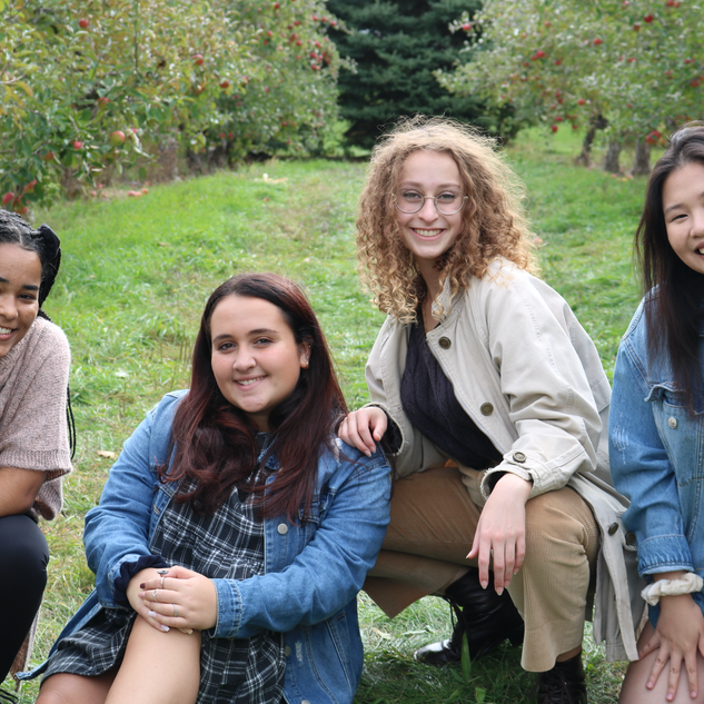 (from L to R) newbies Allayna Hight, Morgan Kaplan, Allie Lavacek, and Jenny Cai post for a photo at the Apple Orchard Social (Fall 2020).