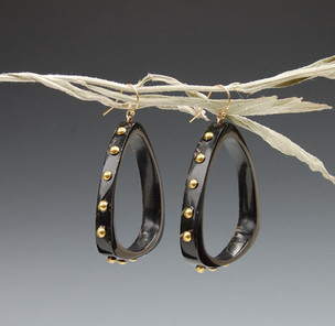 Buffalo Horn earrings with brass tacks. Natural shine