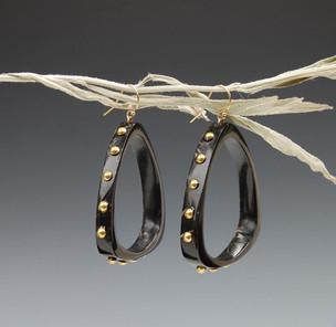 Buffalo Horn earrings with brass tacks. Natural shine