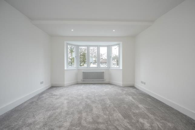 Bedroom with gray carpet and white walls