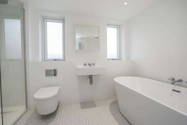 Bespoke bathroom with Mosiak white floor