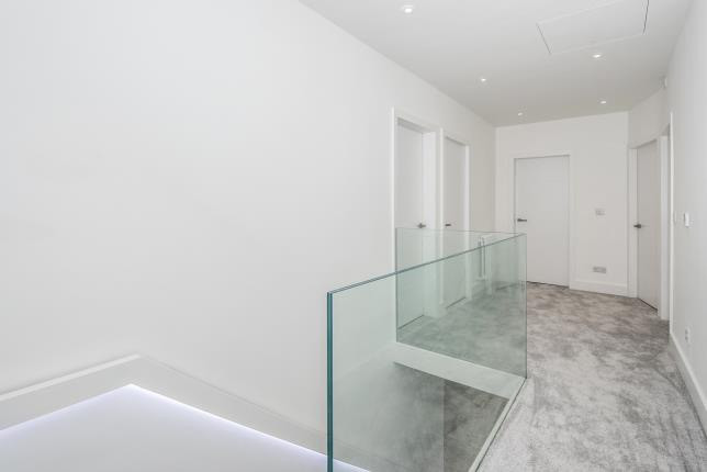 Glass frameless stairs with LED lights on steps