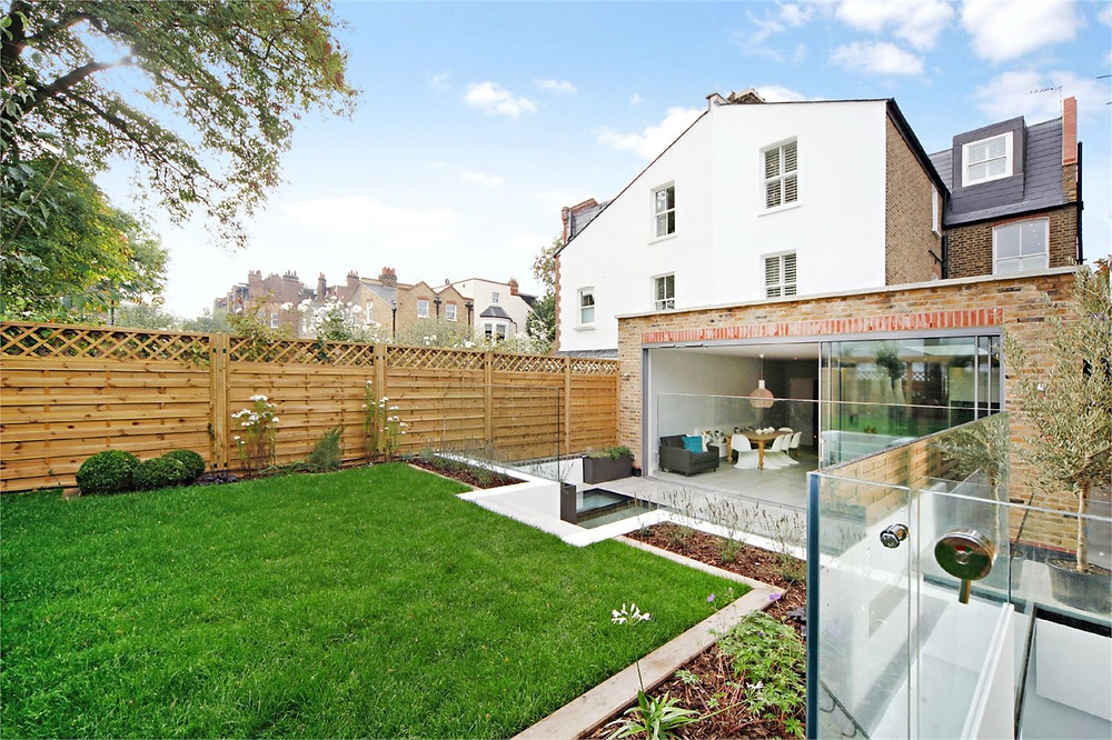 Single storey wraparound home extension with a basement