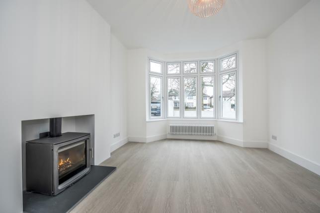 Living room with fireplace and U shape windows