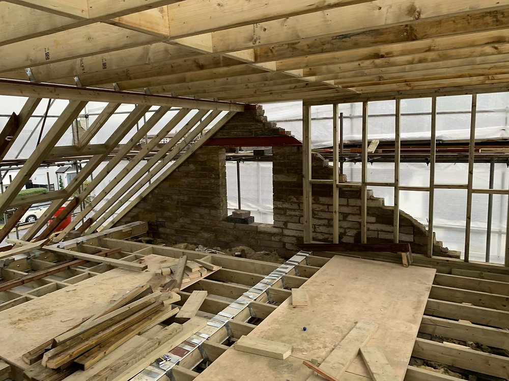 Structural framing out with timber hip to gable loft