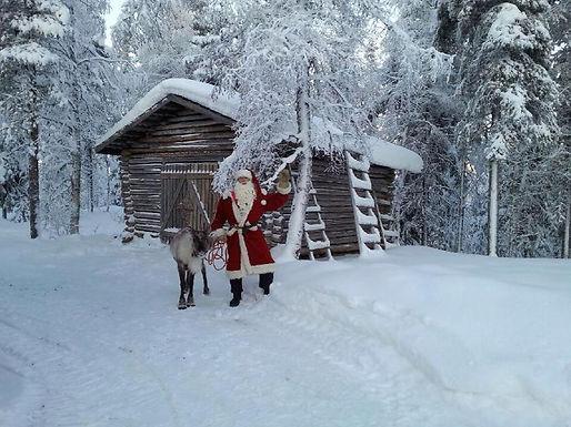 Joulupukki poron kanssa