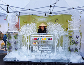 Outdoor ice stand for bar/drink service - incorporated logos and features ice pillars on each side.