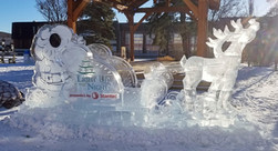 Seasonal ice sculpture - featuring a sleigh and reindeer with seating room for two people.  Also features a Santa cutout for photo opportunities by placing your face through the face hole.