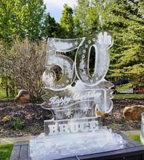 Theme drink luge run ice sculpture - Happy 50th Birthday.