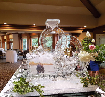 Wedding ice sculpture - featuring wedding rings and the couple's photo frozen into the ice.