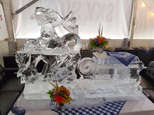 Western theme ice sculpture with a Corporate logo - featuring a tray on top of the logo which was used for food/drink service.