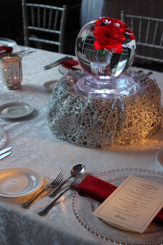 Ice Globe table centerpiece with red roses frozen inside.