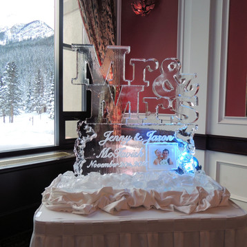 Wedding ice sculpture - Mr & Mrs design with couple's photo frozen into the ice and their names and wedding date engraved.