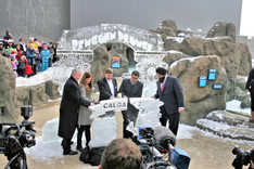 Outdoor Ice Archway with Ice Ribbon for ribbon cutting ceremony.