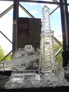 Theme ice sculpture featuring oil rig and Corporate logo.  Drink luge run is incorporated into design.
