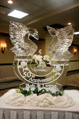 Theme ice sculpture - 50th Anniversary - featuring two hand carved swans on an oval base.