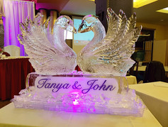 Wedding ice sculpture - Kissing Swans on base with names engraved.