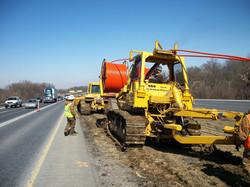 adb-plowtrain in action along roadway-no antenna