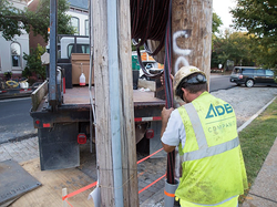 An ADB employee carefully installs cable