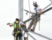 Two ADB workers scale a wireless tower t