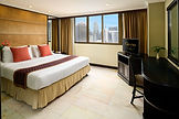 Deluxe Suite_Bedroom.jpg