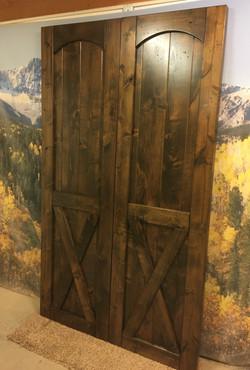 Alder dark stain distressed barn door