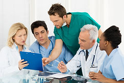 Team Of Experts Doctors Examining Medica