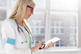Female doctor looking at medical records