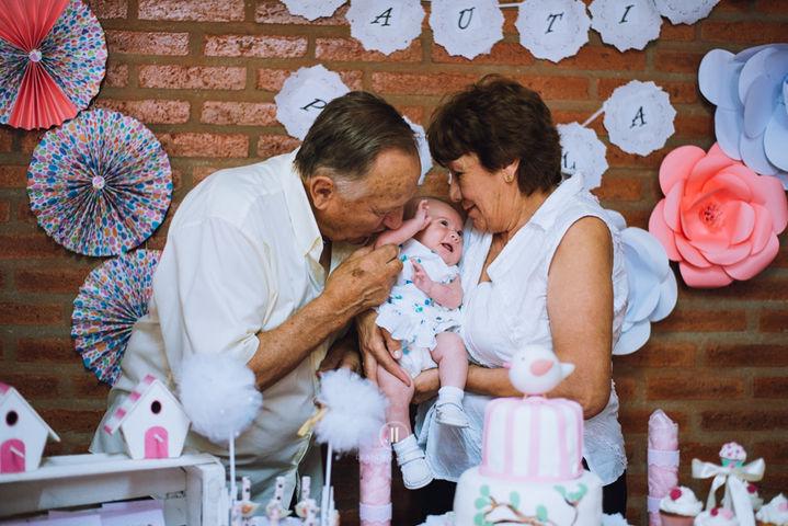 Abuelos con la beba, bautismo en lozada cordoba