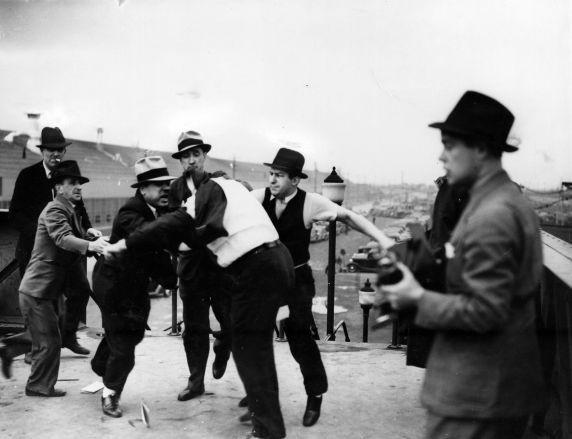 Harry Bennett roughs up union men.