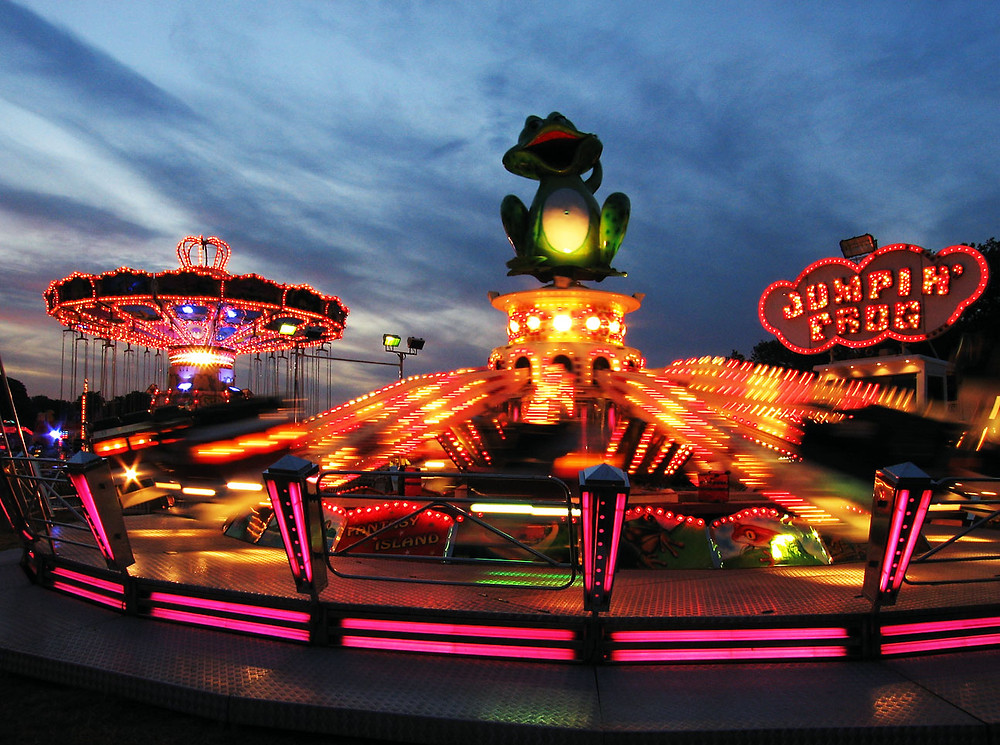 A fair ground filled with rides powered by hydraulics