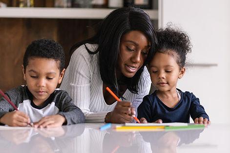 Mum writing with kids.jpg