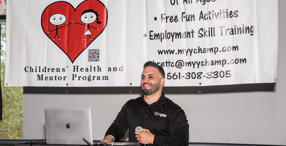 CLICK THE PIC TO ENLARGE PHOTOS. Sergio the DJ kicking it off. Our new banner, purchased from Moondog Creations  is proudly displayed overhead.