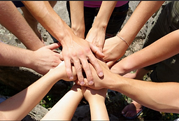 Caucasian human hands joined at one point to symbolize we are all in this together.