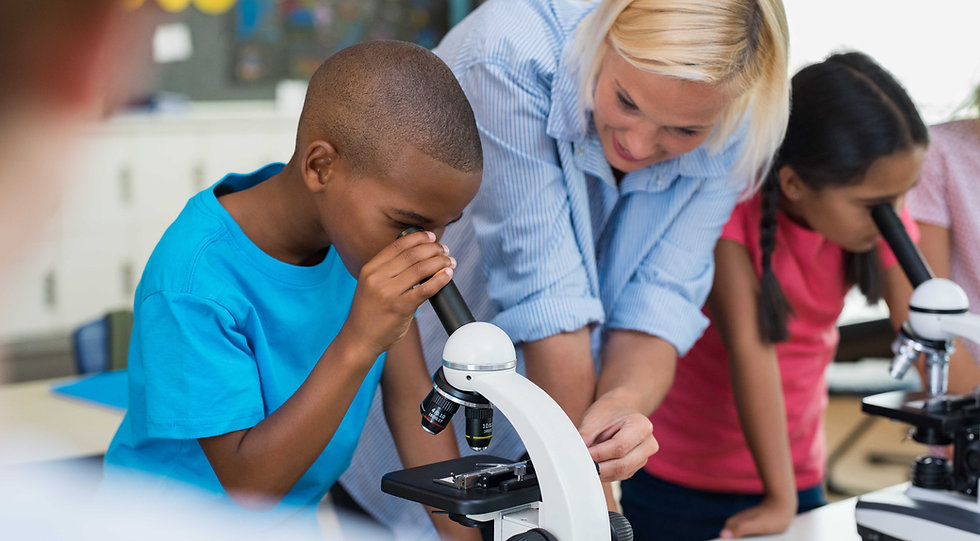 children-scholar-looking-through-microsc