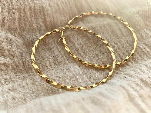 Gouden ringen gedraaid