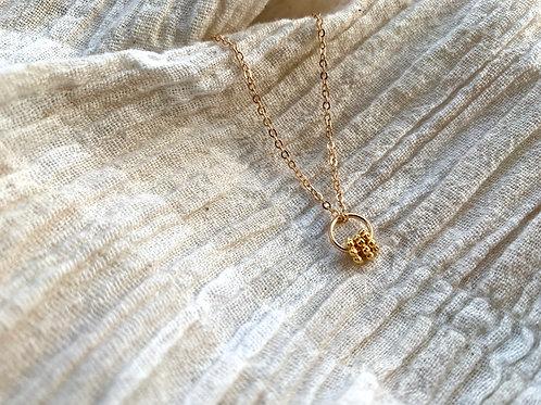Gouden ketting met 3 Bali ringen