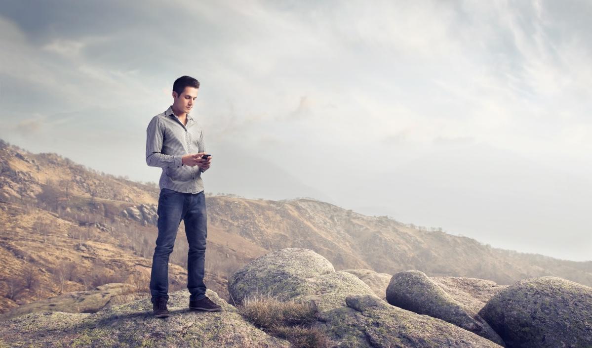 Tourist Using Phone in Nature