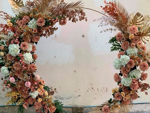 Gold & orange flowers with full circle round arch.