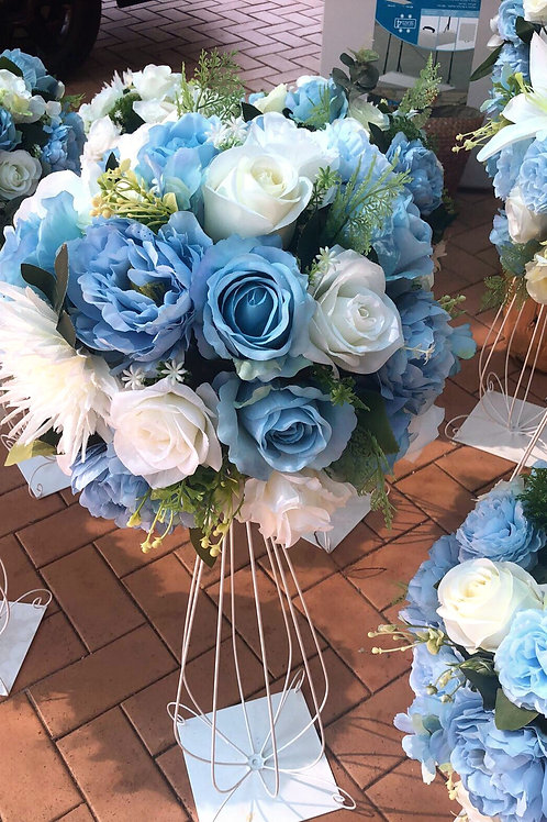 blue & white flowers centerpiece with metal vase .