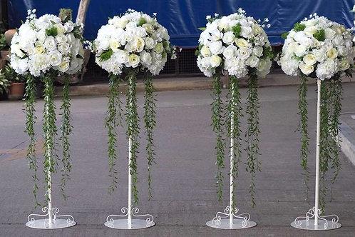 white flower stands pillar