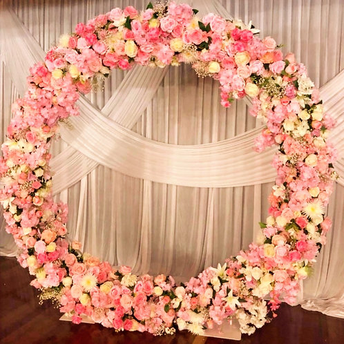 Pink & white flowers with full circle arch.
