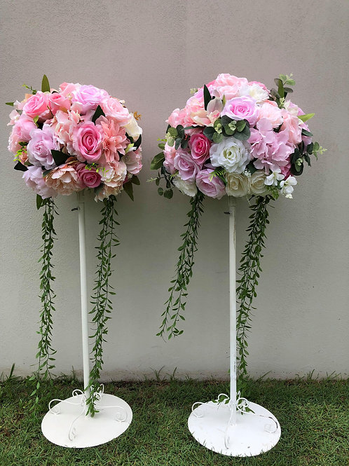 pink & white flowers stand .