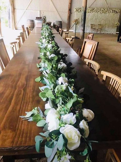 Greenery table centerpiece garland with flowers.